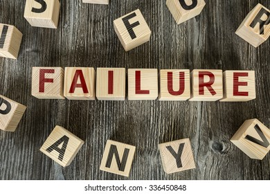 Wooden Blocks with the text: Failure