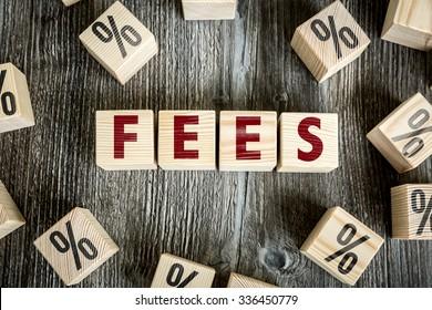 Wooden Blocks with the text: Fees