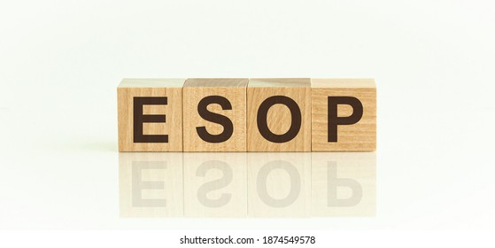 Wooden blocks with the text: forex. The text is written in black letters and is reflected in the mirror surface of the table. Forex - market for interbank exchange at free prices.