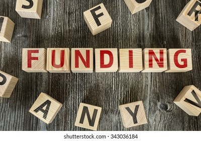 Wooden Blocks with the text: Funding