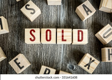 Wooden Blocks with the text: Sold