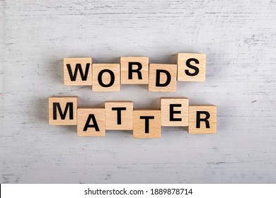 wooden blocks  in a white and grey board with the text words matter