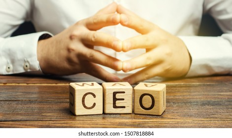 Wooden blocks with the word CEO and businessman. Chief Executive Officer. Boss, top management position in a team or company. Leader, Leadership. Business concept