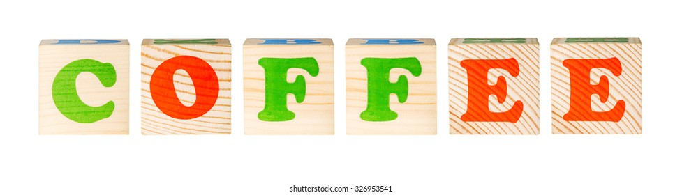 wooden blocks with the word coffee isolated on a white background