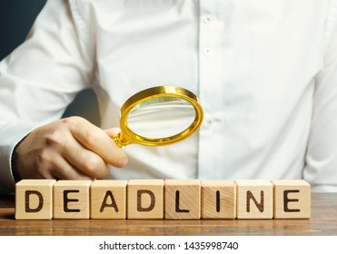 Wooden blocks with the word Deadline and freelancer. A narrow field of time by which an objective must be accomplished. Time limit. Implementation of tasks and stages of the project. Business concept