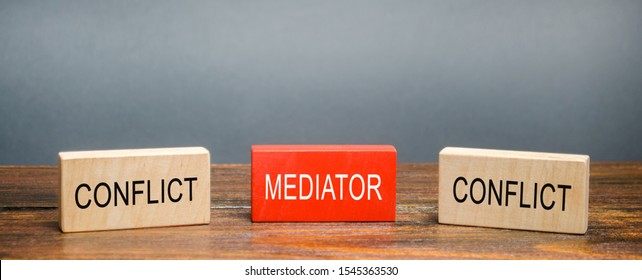 Wooden blocks with word Mediator and conflict. Settlement of disputes. Conflict resolution and mediation. Third party, intermediary. Solution problem.