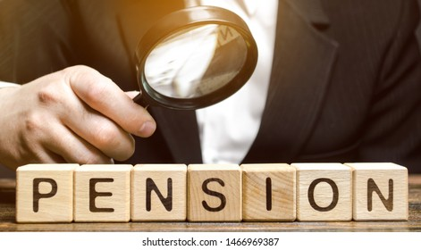 Wooden blocks with the word Pension and a magnifying glass in the hand of a man. Analysis of retirement payments. The size of pensions. Pension Fund. Financial condition of older people. Supplements