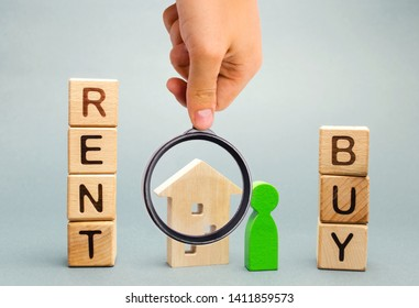 Wooden blocks with the word Rent or buy and a person stands near the house. Make the right decision. Real estate concept. Rent apartment. Property. Rental, renting home. Buying. Purchase housing