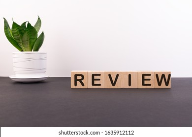 Wooden blocks with the word Review. Customer review concept. Reviewing, auditing, reviewer. Service rating. Feedback.