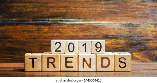 Wooden blocks with the word Trends 2019. Main trend of changing something. Popular and relevant topics. New ideological trends of fashion. Recent and latest trend. Evaluation methods. Fashionable