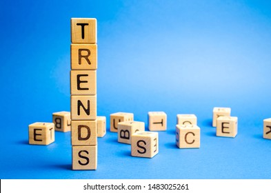Wooden blocks with the word Trends. Popular and relevant topics. New ideological trends of fashion. Recent and latest trend. Evaluation methods.