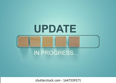 Wooden blocks with the word UPDATE  in loading bar progress. Business concept for act updating something someone or updated version program.