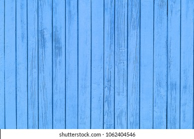 Wooden blue desks wall backdrop.