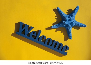 Wooden blue welcome sign with star on yellow background. welcome
