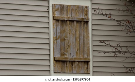 Wooden board and batten shutter on a residential home