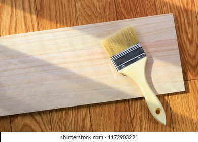 Wooden board and brush