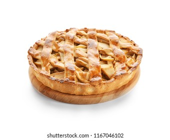 Wooden board with delicious apple pie on white background