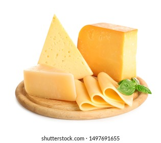 Wooden board with different kinds of cheese and basil on white background - Shutterstock ID 1497691655