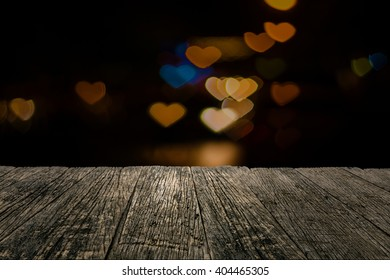 Wooden board empty table in front of blurred background. light heart bokeh