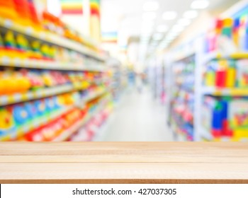 Wooden board empty table in front of blurred background. Perspective light wood over blur in kids toys store - can be used for display or montage your products. Mock up for display of product.