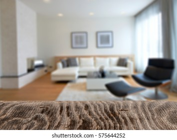 Wooden board empty table in front of blurred background. Perspective light wood over blur in living room interior- can be used for display or montage your products. Mock up for display of product