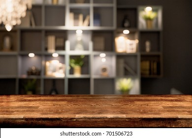 Wooden board empty table in front of blurred background. Dark wood over blur in living room interior- can be used for display or montage your products. Mock up for display of product.