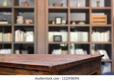 Wooden board empty table space platform in front of blurred library Of The background - can be used for display or montage your products. Mock up for display of product