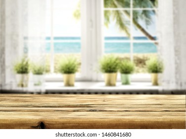 Wooden board of free space for your product and blurred background of window space