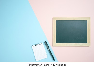 Wooden board on pastel background