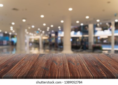 Wooden board over blurred background, perspective empty wood table over defocus background, mockup wooden desk for display or montage your products