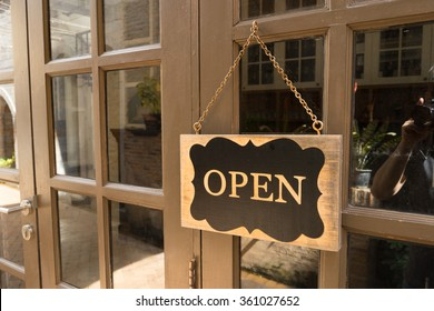 Wooden board sign that says Open from a restaurant