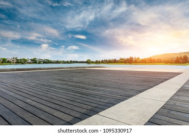 Wooden board square floor and apartment building with cloud landscape in the city suburbs