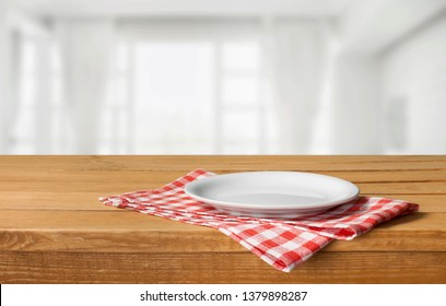 Wooden board stand on tablecloth over grunge