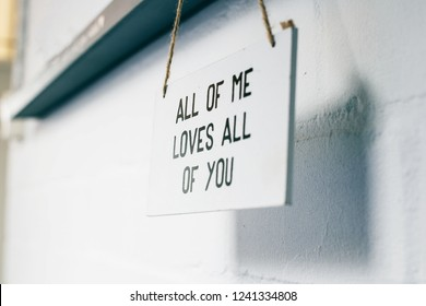 Wooden board with text all of me loves all of you, love sign on the wall home interior modern decoration romantic texture