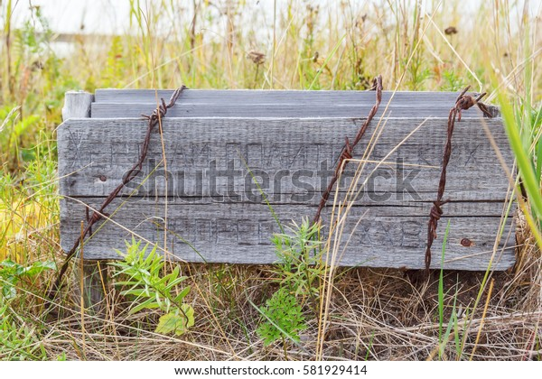 "Wooden board ""victims of political repression of the XX century"" in the Pine desert on the Big Solovetsky Island"