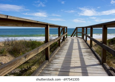 Wooden board walk steps leading up to the lookout of the Indian Ocean on a sunny  day  in late winter at Dallyellup Beach near Bunbury , South Western Australia.