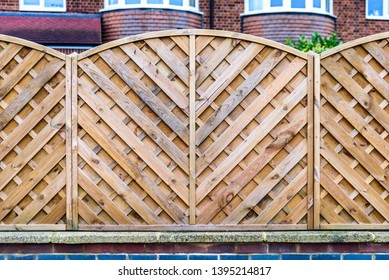 wooden boarded fence background in english town uk