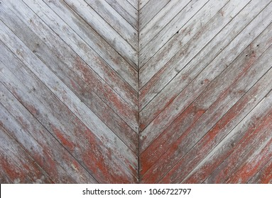 Wooden boards are diagonal strips. The wall panel is a horizontal shabby texture. Restored surface of wood. Close-up. External surface of the fence.