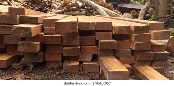 Wooden boards, lumber, industrial wood, timber. Building bar from a tree and an edging board in stacks. Stacked wooden bars on a lumber yard