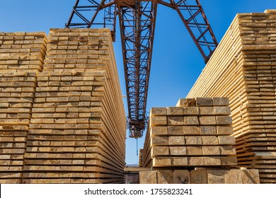 Wooden boards, lumber, industrial wood, timber.  Finished products under an industrial crane.