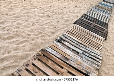 Wooden boards path on the sandy beach