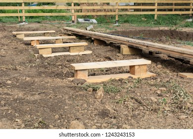 Wooden boards and planks, stand for boards on the construction of a frame house
