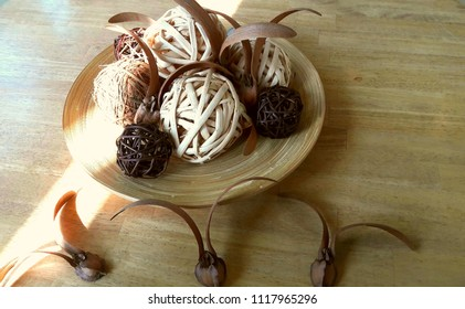 Wooden boards with wooden tangle handmade pieces and dipterocapus alatus seeds of wild trees placed on wooden tables.