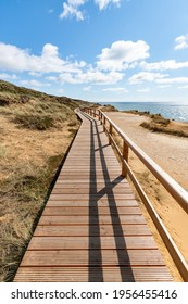 Wooden boardwalk along the Rotes Kliff (red cliff), Sylt, Schleswig-Holstein, Germany