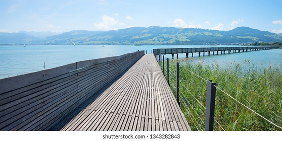 wooden boardwalk between rapperswil and hurden, lake zurichsee switzerland