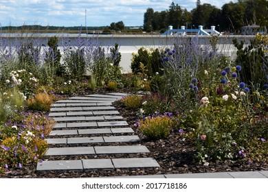 Wooden boardwalk in the green garden. High quality photo