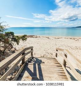 Wooden boardwalk in Maria Pia beach, Alghero. Sardinia, Italy