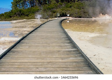 Wooden boardwalk over champagne pool in Waiatopu in Rotorua New Zealand