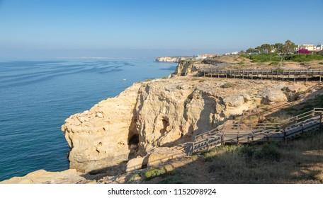 Wooden boardwalk running along the cliff top at Carvoeiro