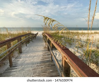 Wooden boardwalk through sea oats and sand dunes overlooking the Gulf of Mexico